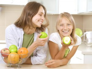 Mother & Daughter Eating Apples